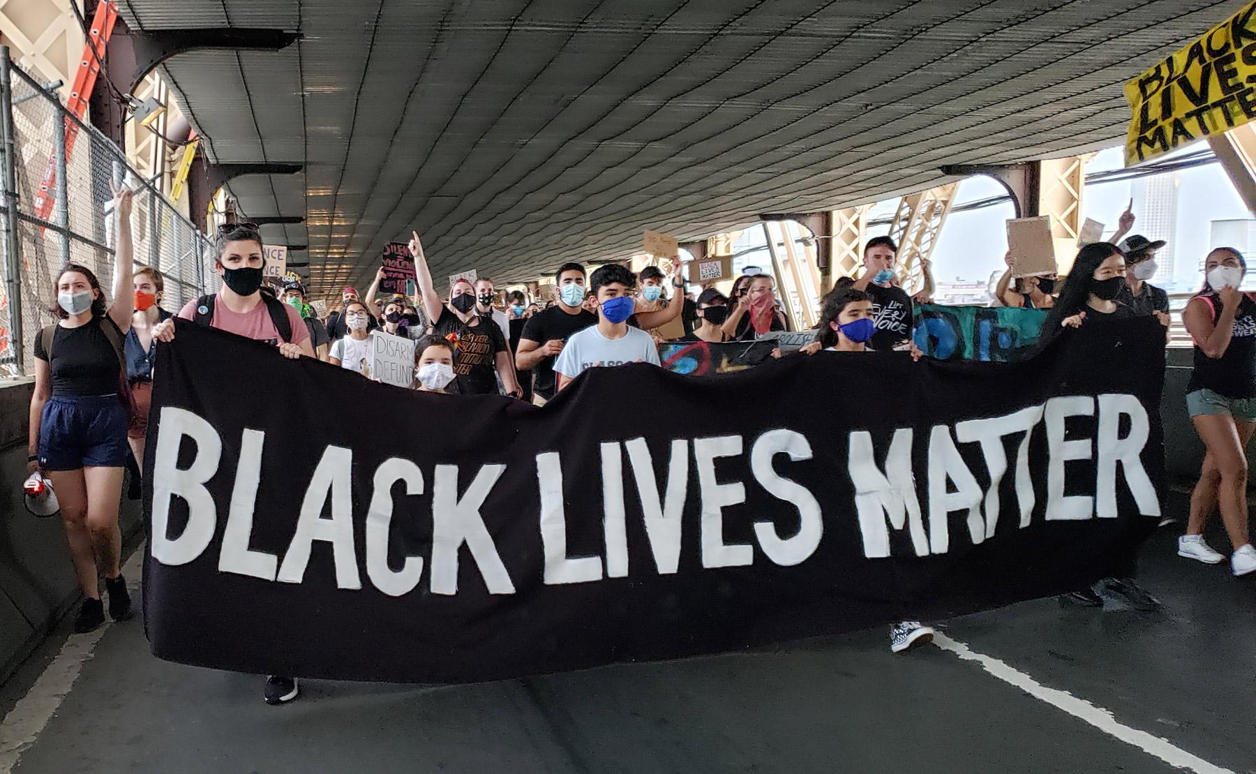 Aleda marches in a Black LIves Matter march across the Queensboro Bridge