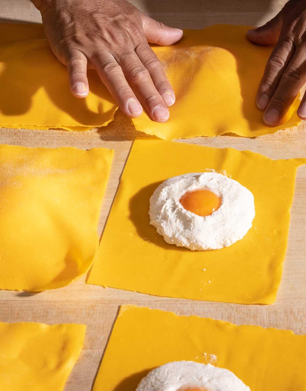 A chef preparing fresh pasta raviolo