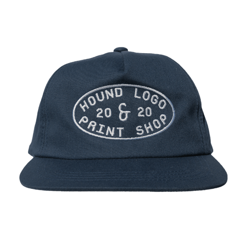 OUR MID-PROFILE SNAPBACK IS A STAPLE OF HOUND STUDIO. THE CAP HAS A SOFT-STRUCTURE WITH A FLAT BILL READY TO BE BROKEN IN. SEWN IN LOS ANGELES, CA.