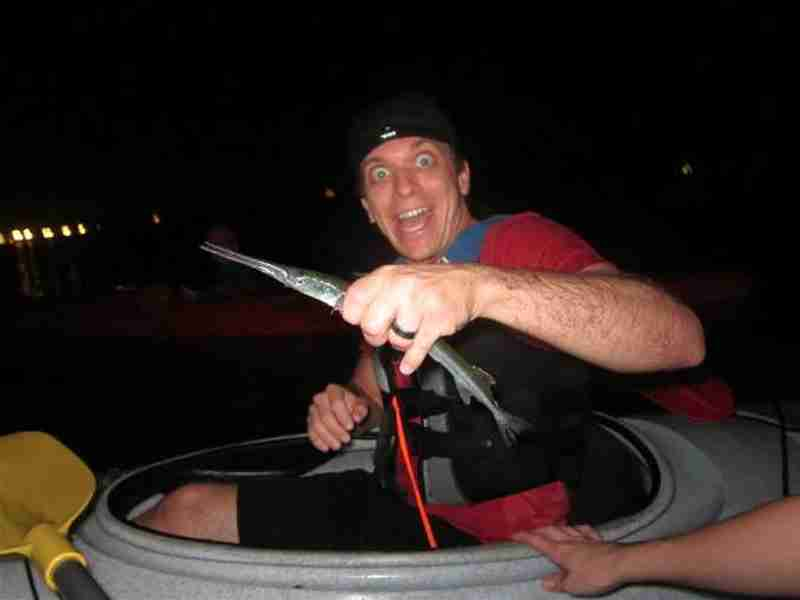 Catching a longnose gar during our night paddle.