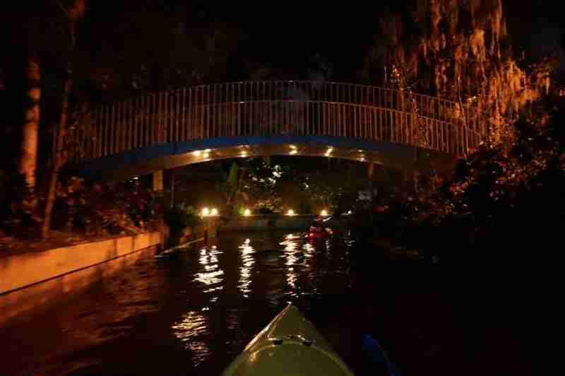 Paddling into on of the beautiful lit up channels at Winter Park Chain of Lakes.