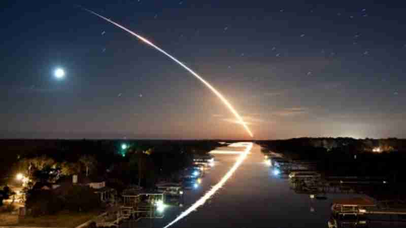 Space rocket takeoff: Time lapse with stars reflection.