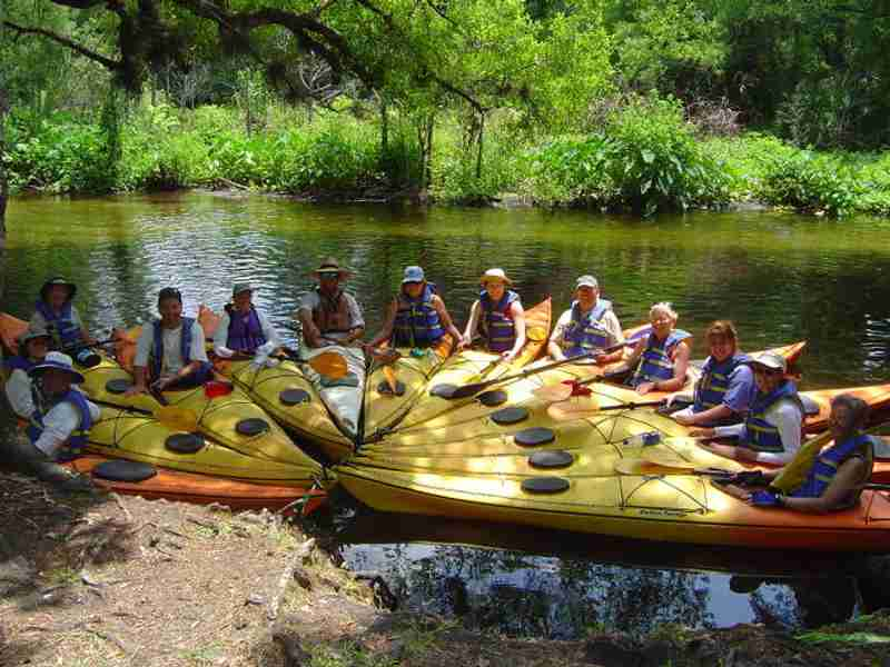 A group of happy kayakers after enjoying a nutritious lunch.