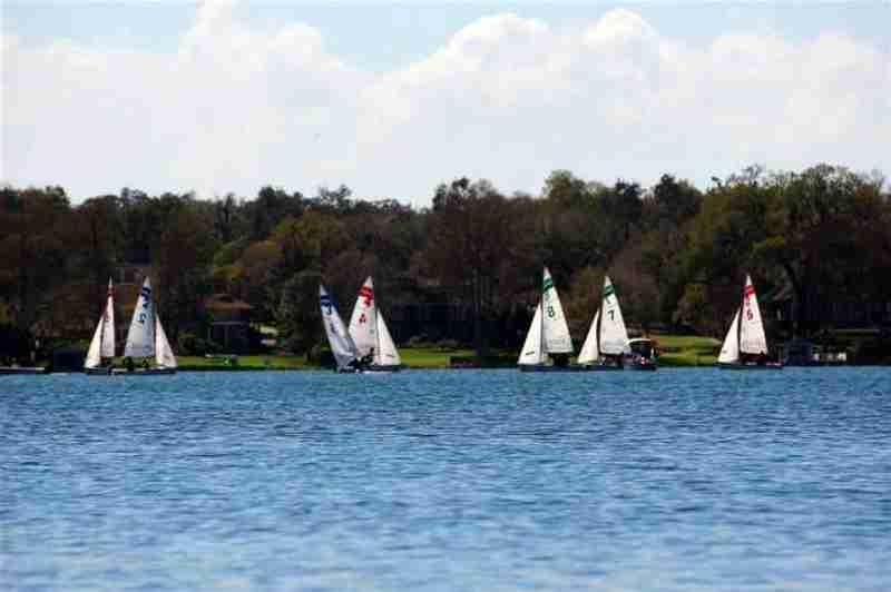 Watching sailing boats while kayaking.