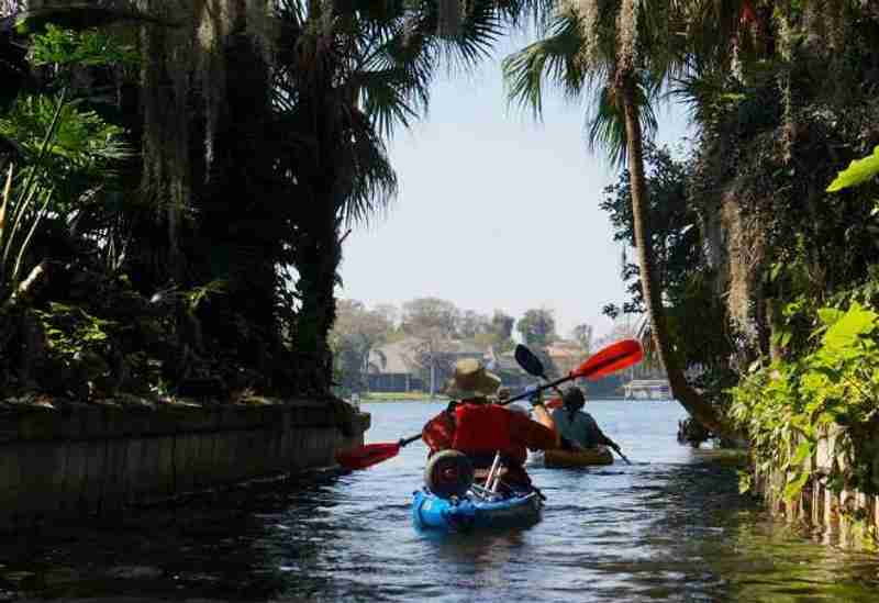 Kayaking along beautiful and historic houses.