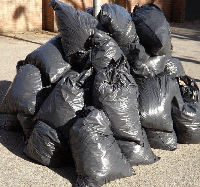 pile of large black garbage bags