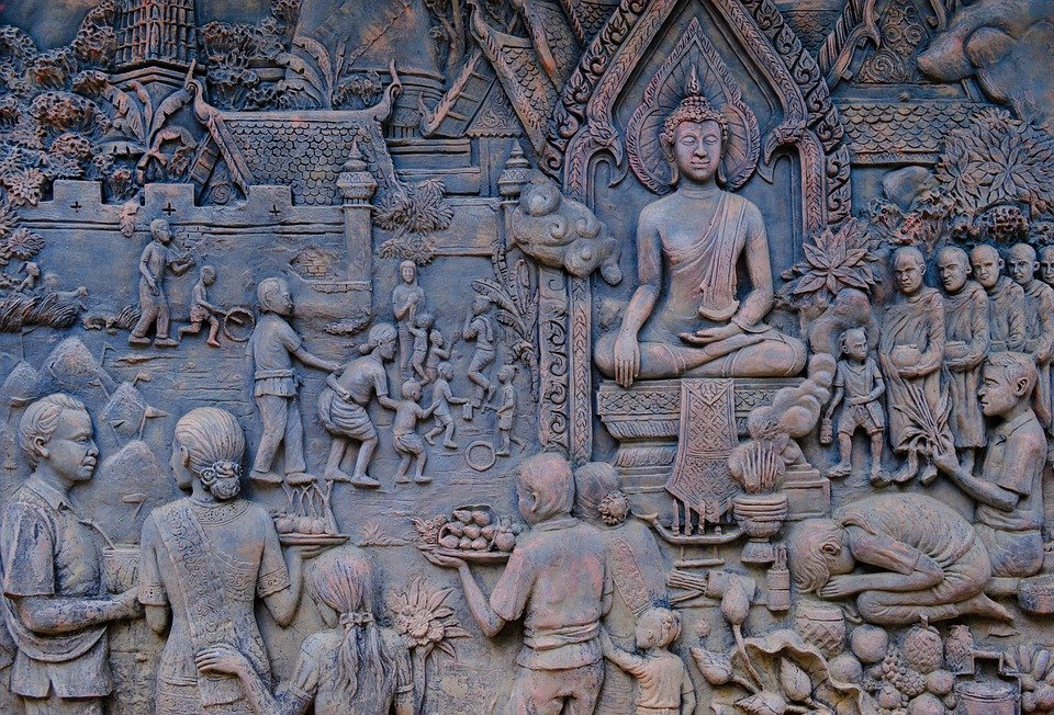 bas relief historical image depicting rural society and buddhism