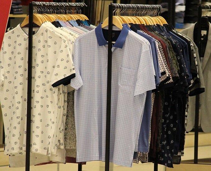 racks of shirts at a clothing store