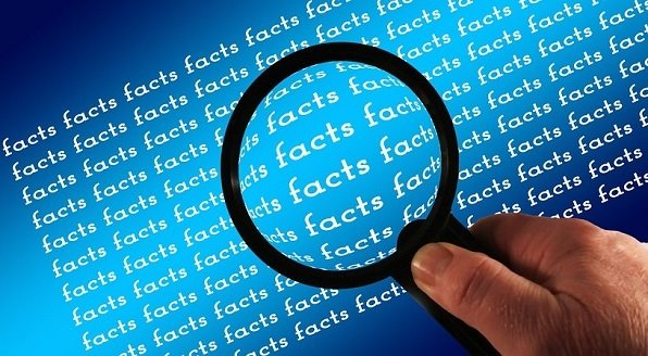 graphic image of a magnifying glass enlarging block of text that repeats the word FACTS over and over.