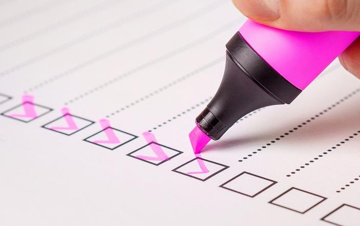 pink highlighter pen checking boxes on a list.