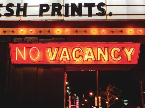 red orange neon sign letters NO VACANCY.