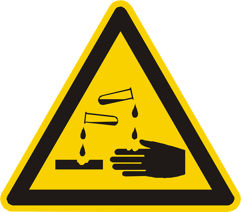 acid burns yellow and black triangle warning sign.