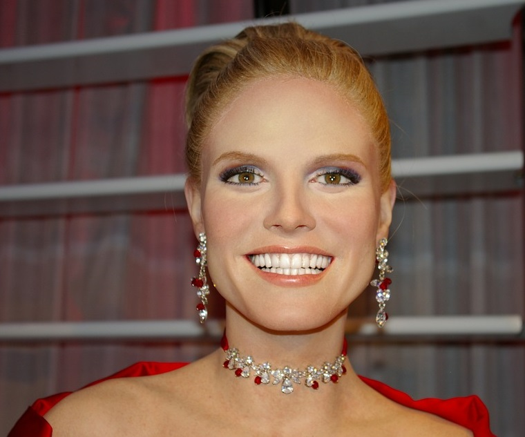 Glamorous Supermodel Heidi Klum in red gown with diamonds and ruby jewelry