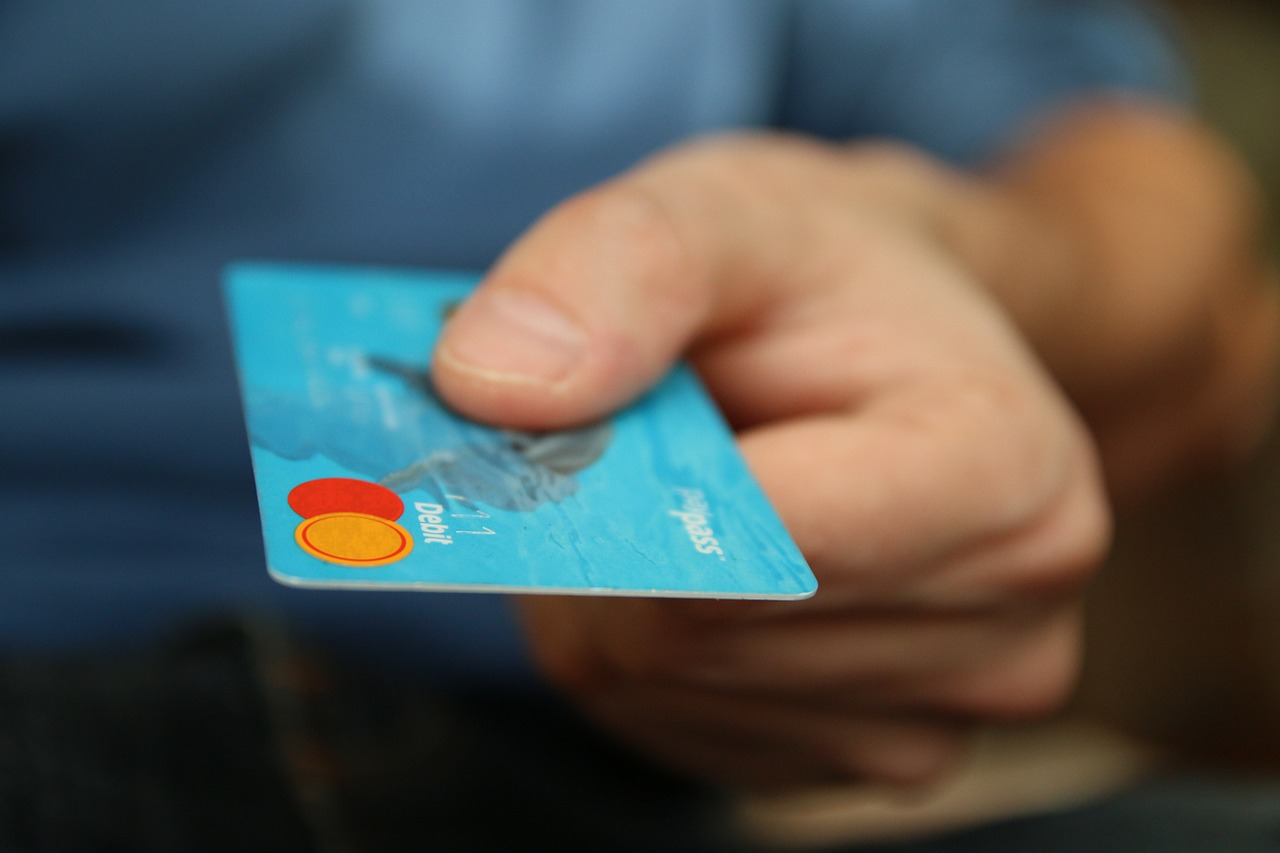 Close up of hand holding a credit card.