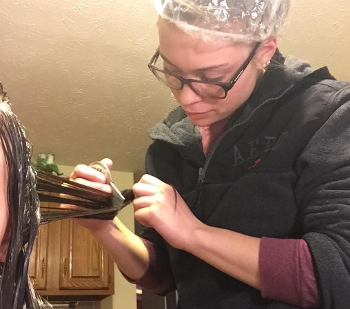 LiceDoctors Professional Technician combing oil soaked hair