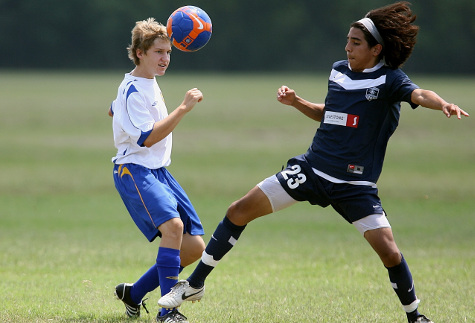 action shot of kids playing soccer