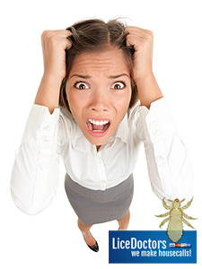Frustrated woman pulling her hair - LiceDoctors