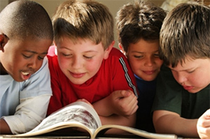 Children reading a book - LiceDoctors