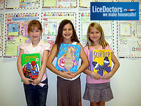 Students showing their text books.