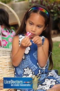 Girl making lei - LiceDoctors