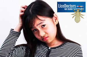 Girl scratching her head - LiceDoctors