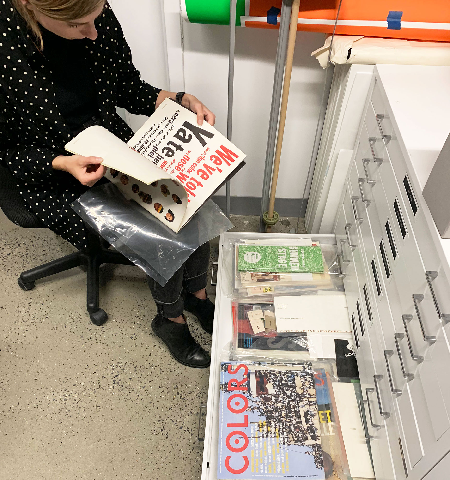 Annie Szafranski looking at magazines at the Herb Lubalin Study Center