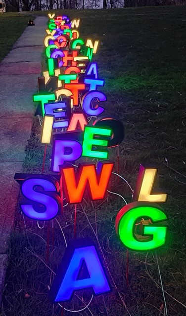 Individual letters mounted into the grass and lit up