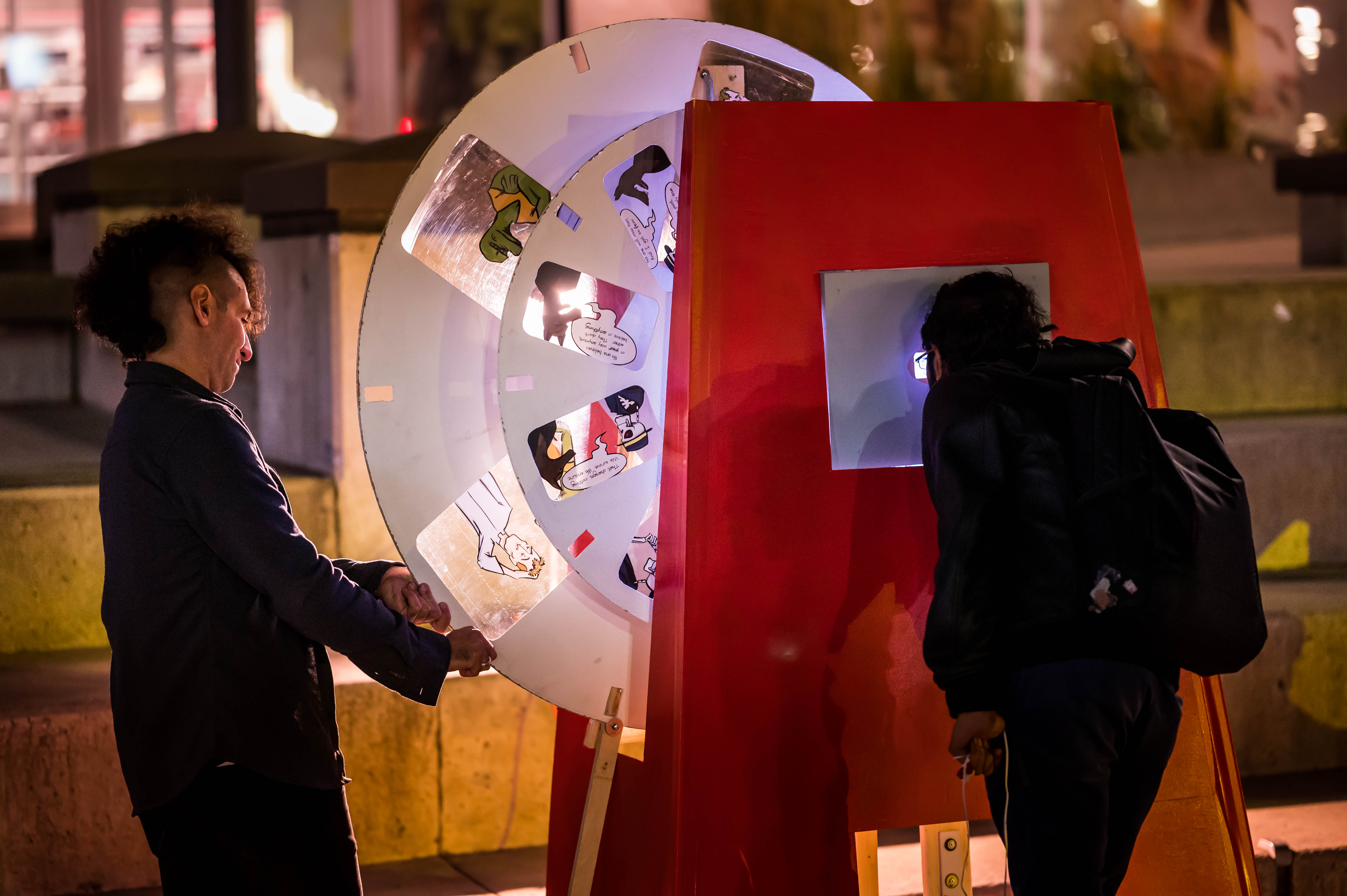 A previous art installation consisting of a person looking through the window of an oversized ViewMaster to see different slides of a comic.