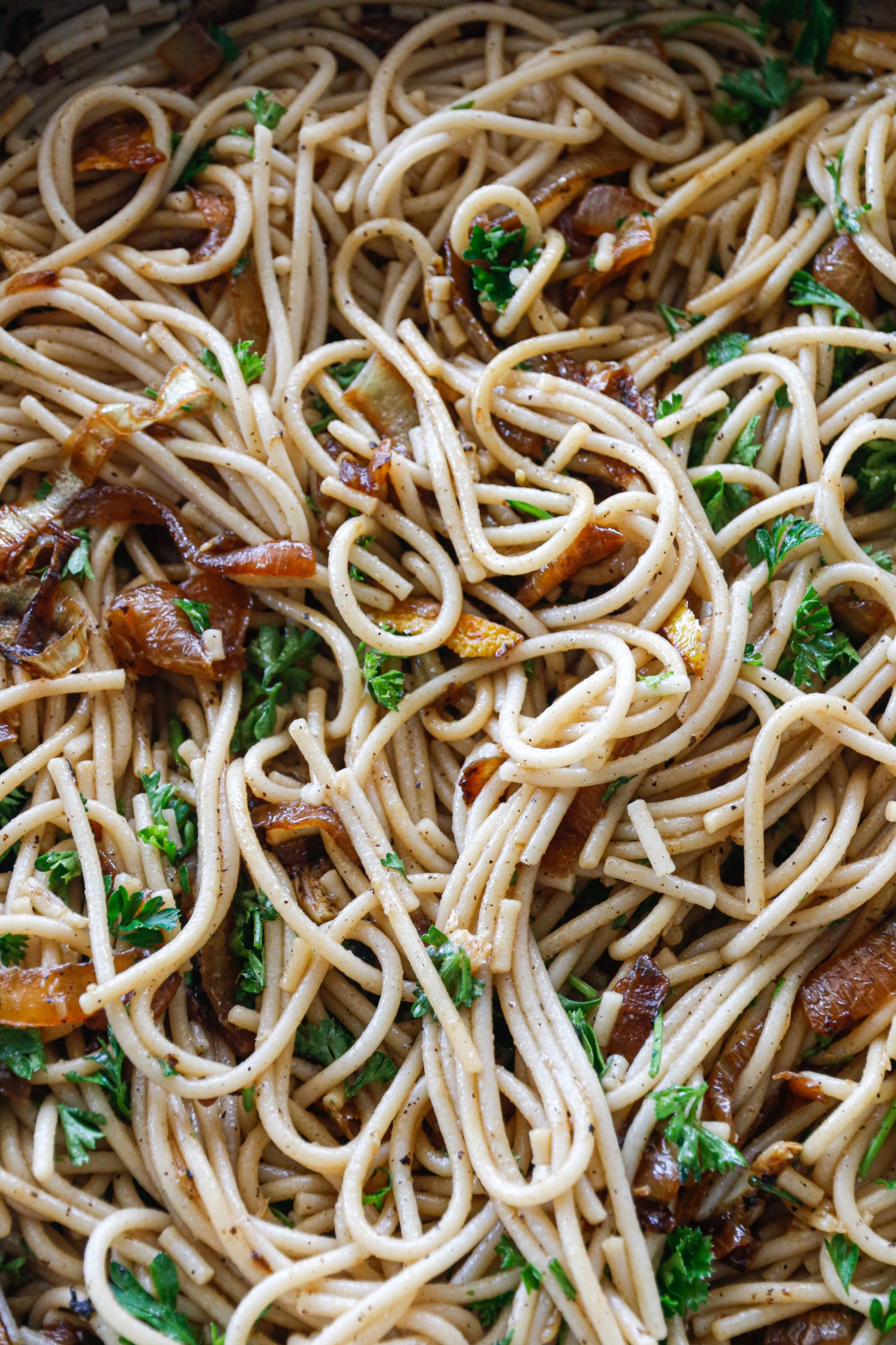 GARLIC PASTA with CARAMELIZED ONION AND LEMON PEELS