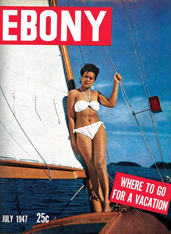 An early Ebony Magazine cover with a model in a white bikini.