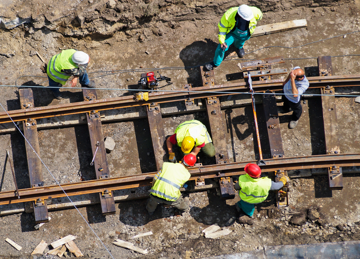 Group of people building a railway