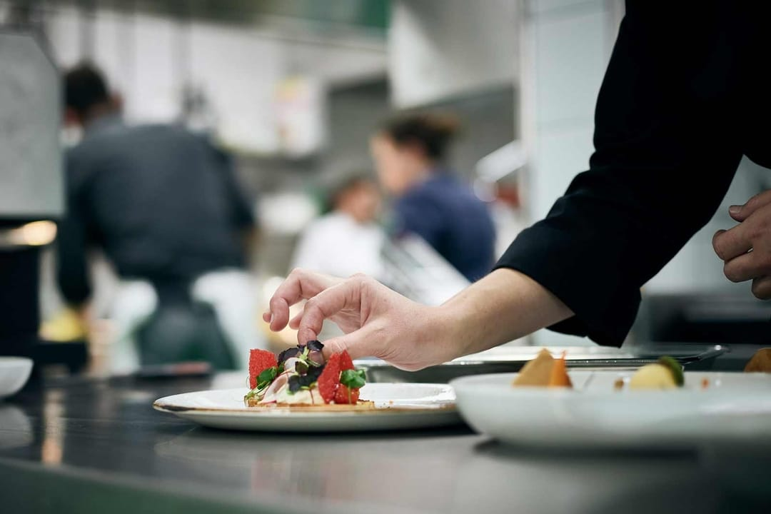 Chef decorates dinner plate