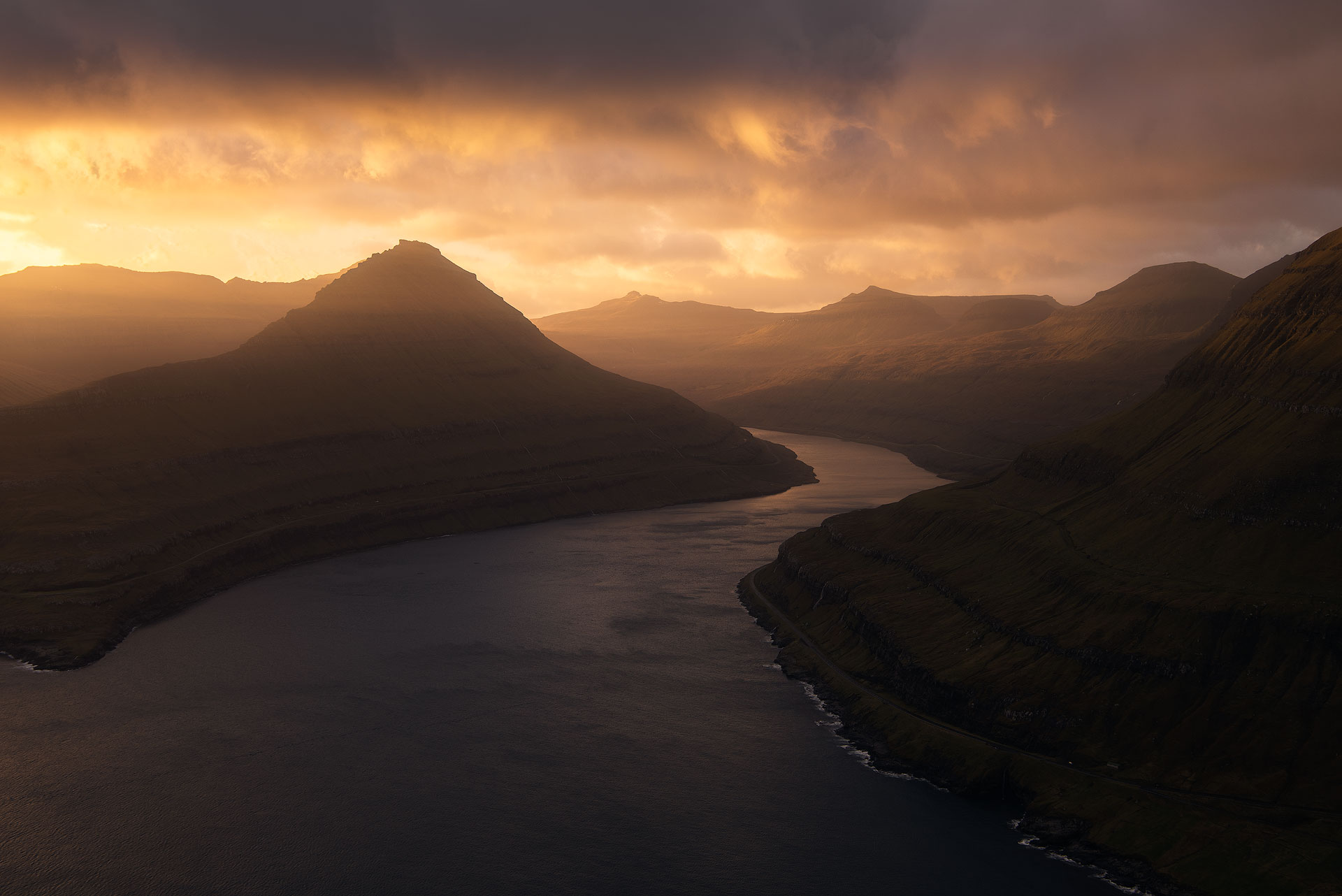Golden hour over mountains and water