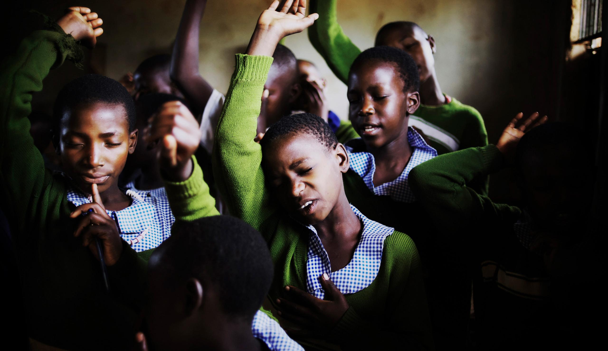 School children in rural Uganda during morning prayer
