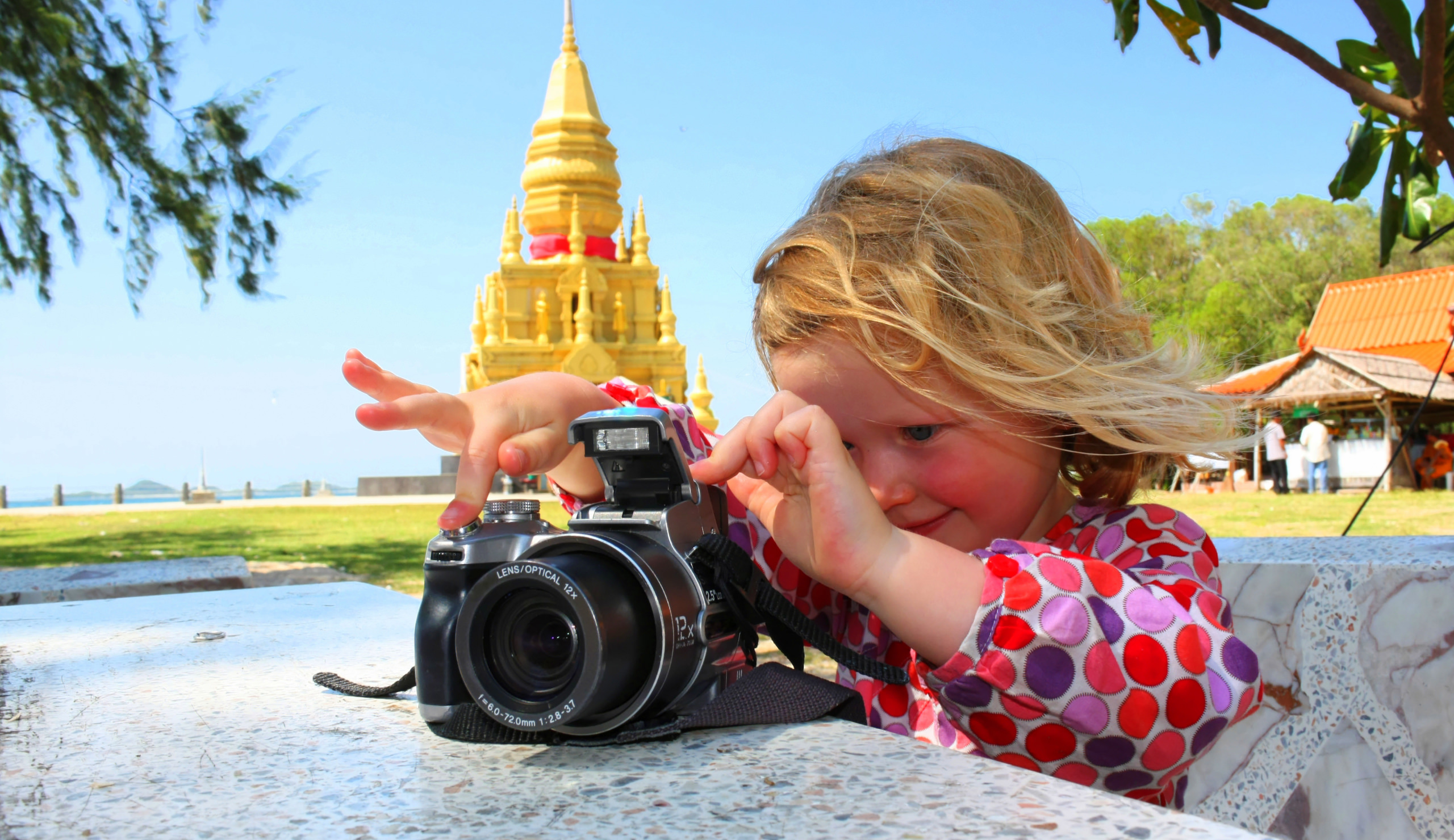 Girl taking a picture on a flat surface