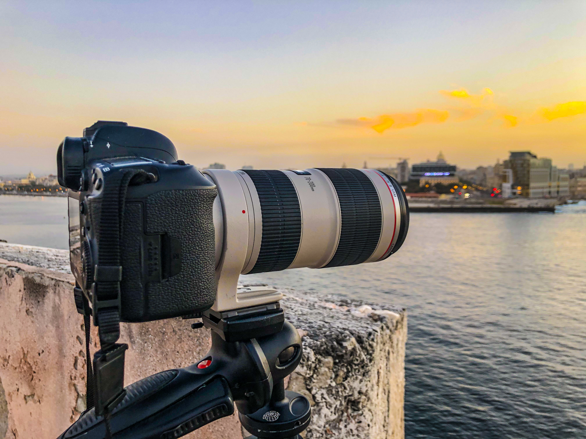 DSLR with a zoom lens overlooking a city