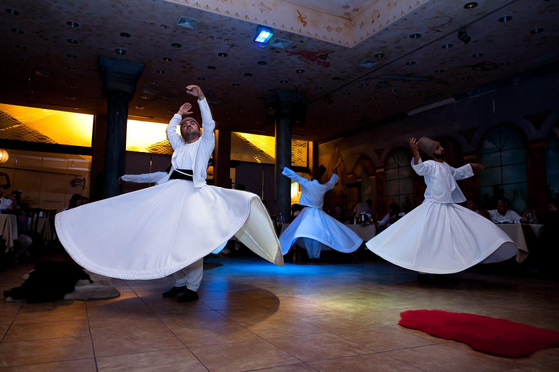 Turkish dancers in an indoor setting