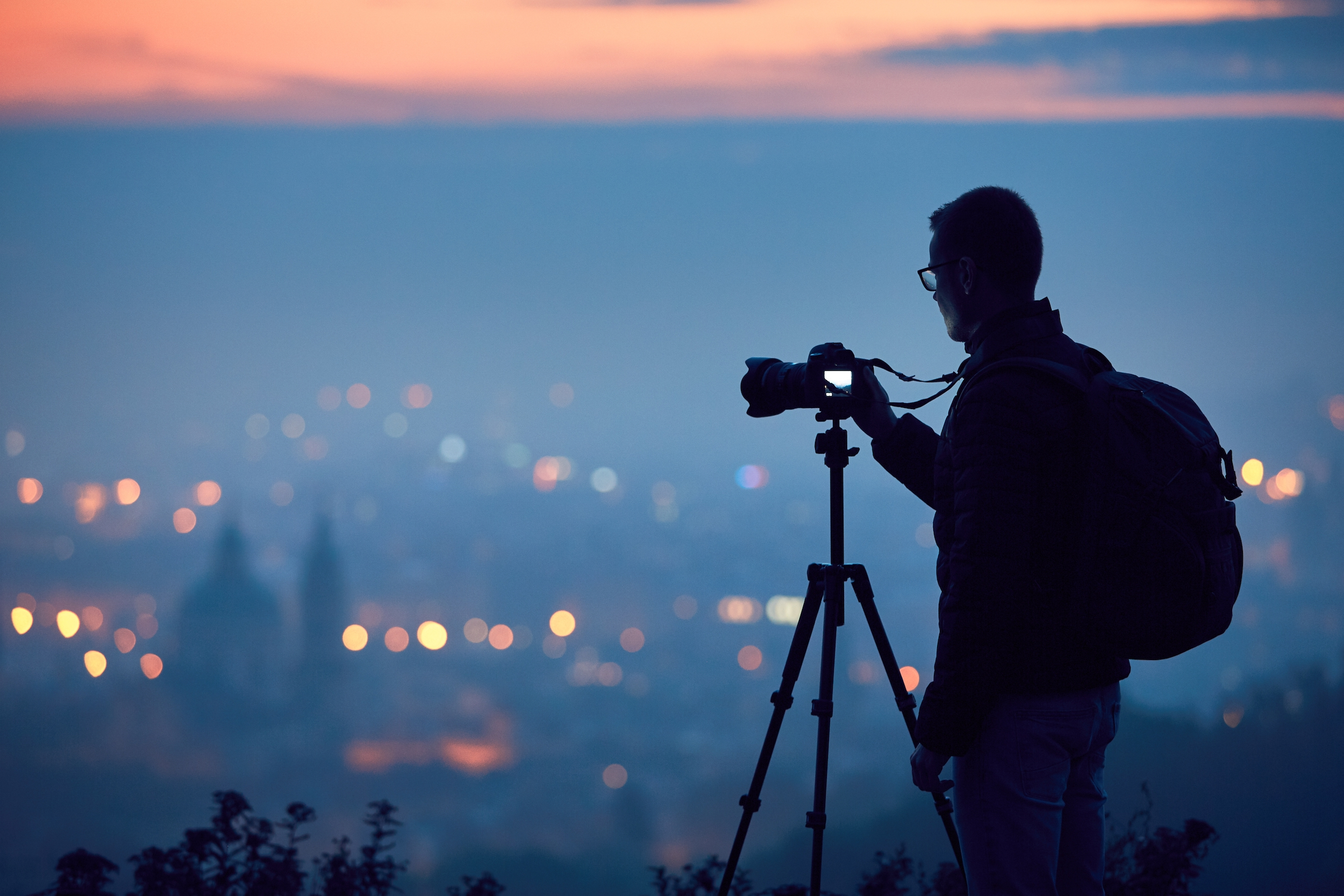 Silhouette of the photographer with tripod.