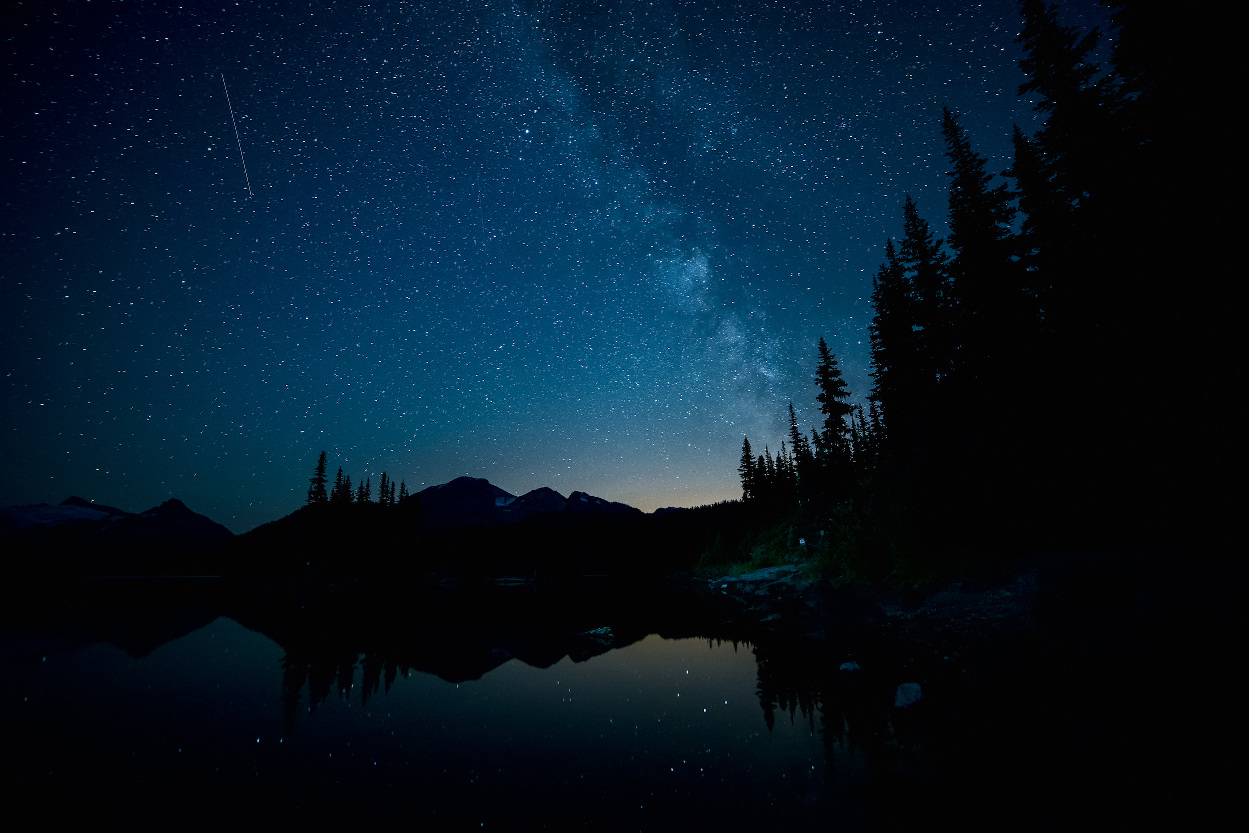 Forest and lake below the the Milky Way