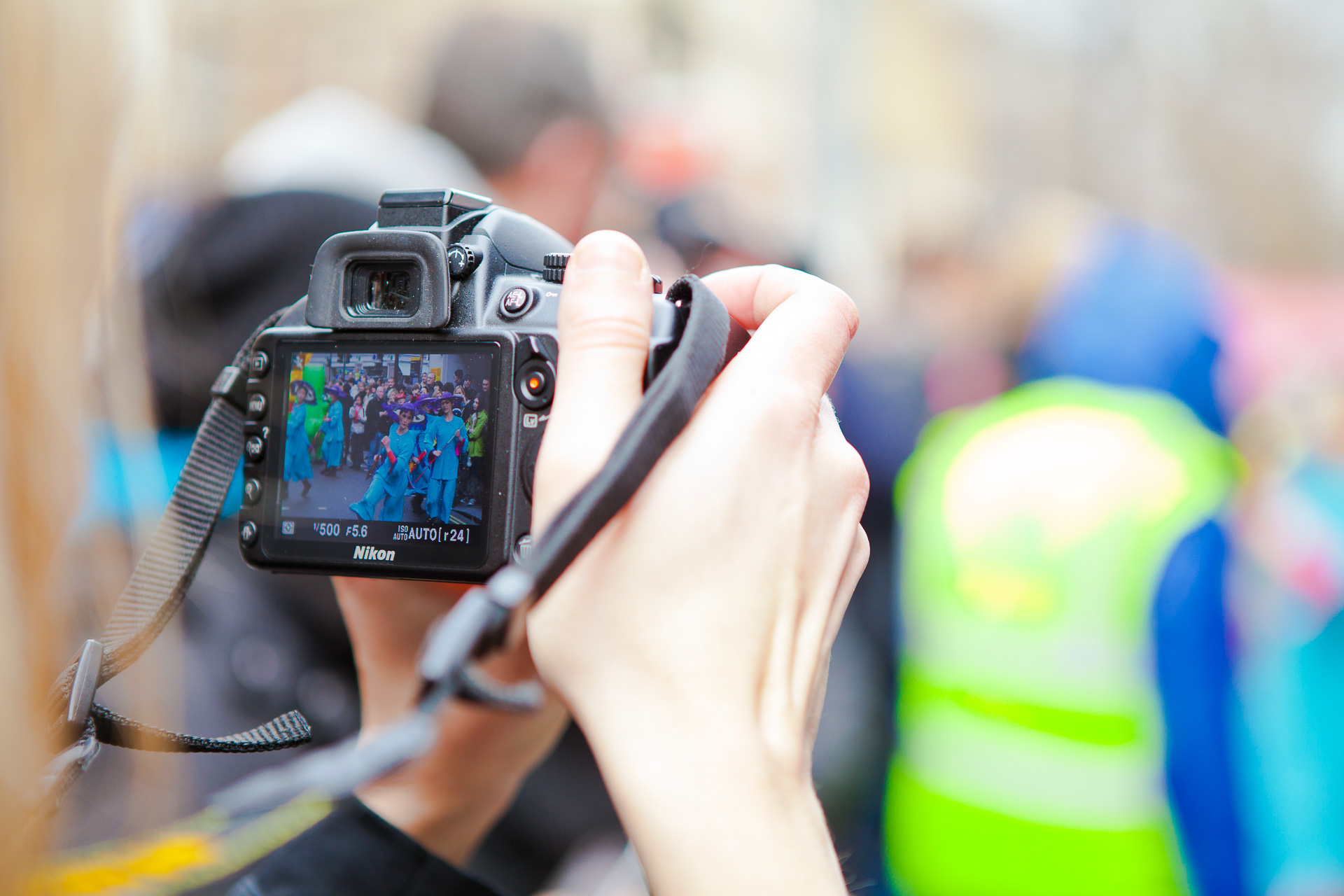 Photographer holding up a camera in a crowd