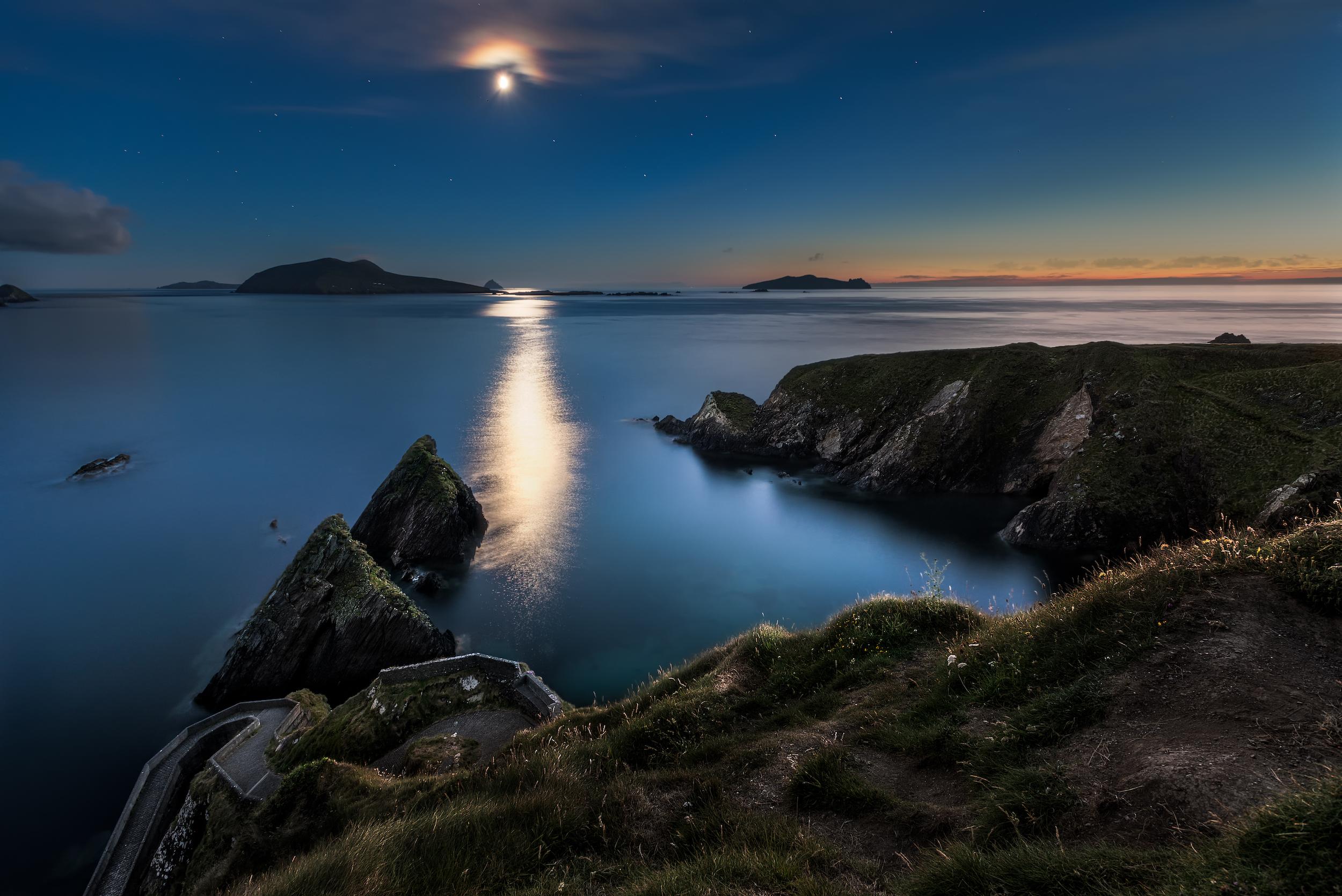 Moonshine at Dunquin Pier, Ireland at midnight in July.