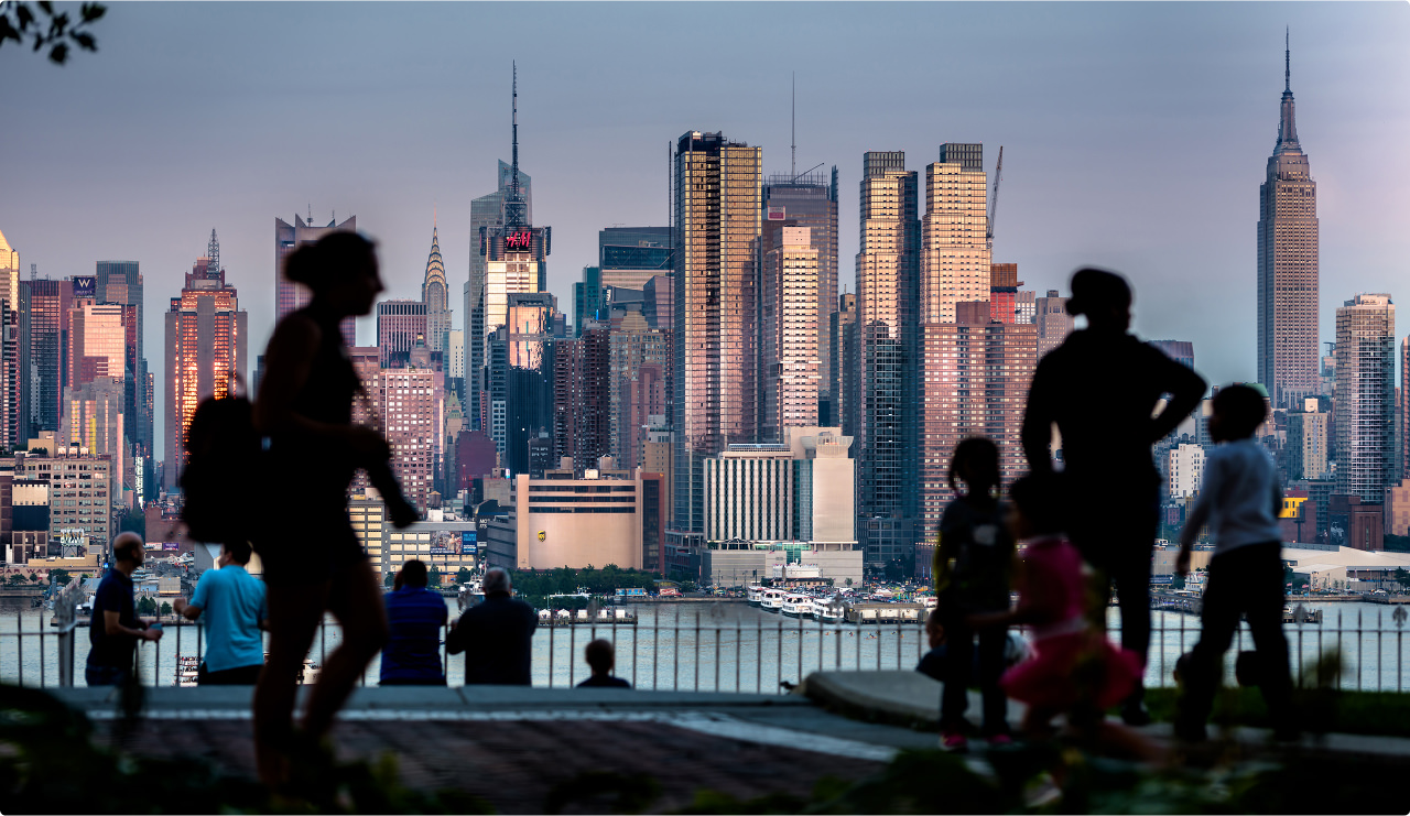 New York City skyline with the silhouettes of people in the foreground