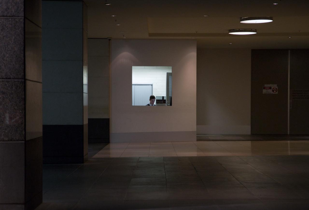 Lonely clerk at a hotel car park, Melbourne, Australia.