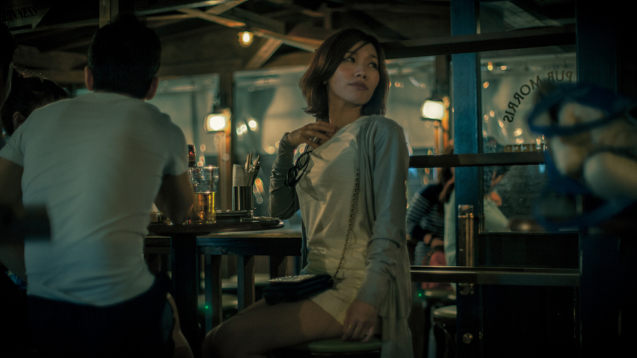 Japanese woman in bar catching the light.