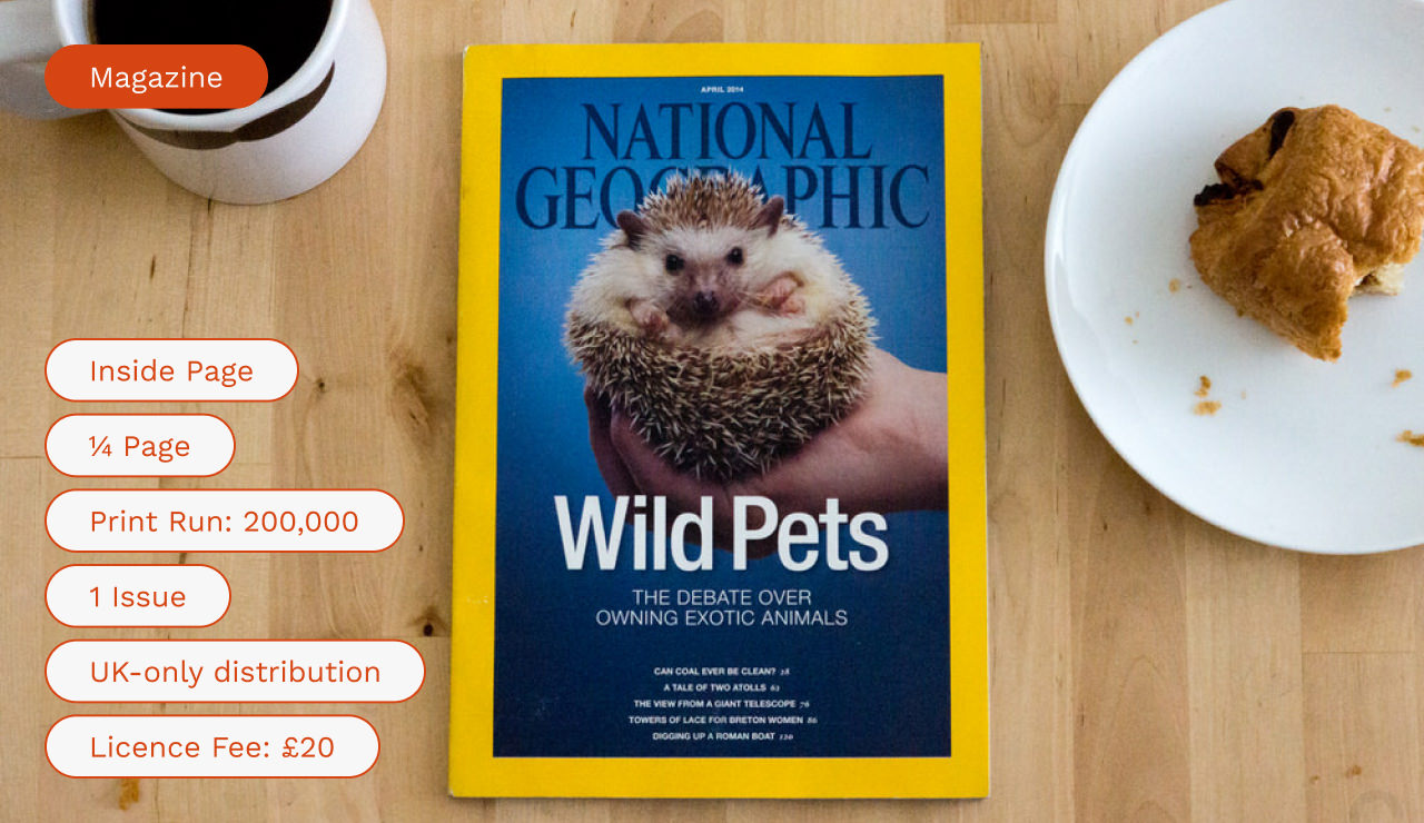 National Geographic magazine on a wooden surface with breakfast items