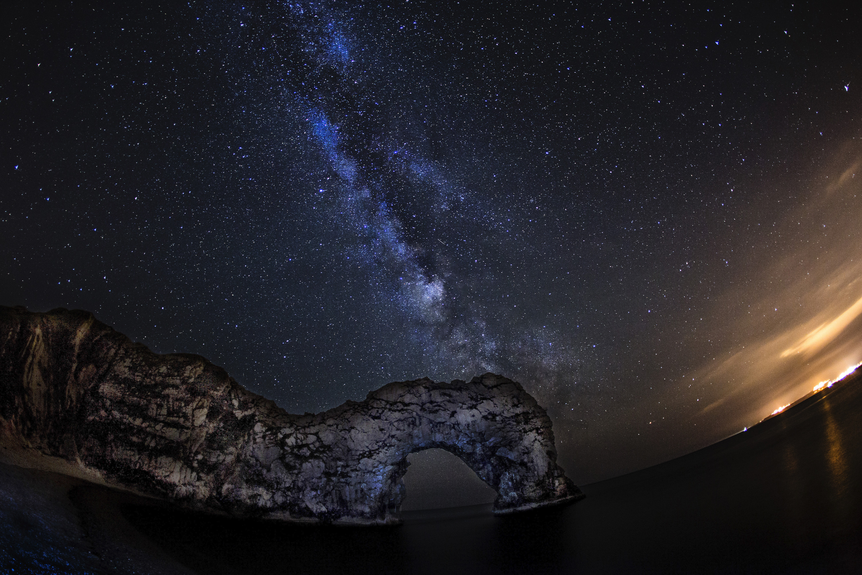 Milky Way over Durdle Door seen through a Fisheye lens.