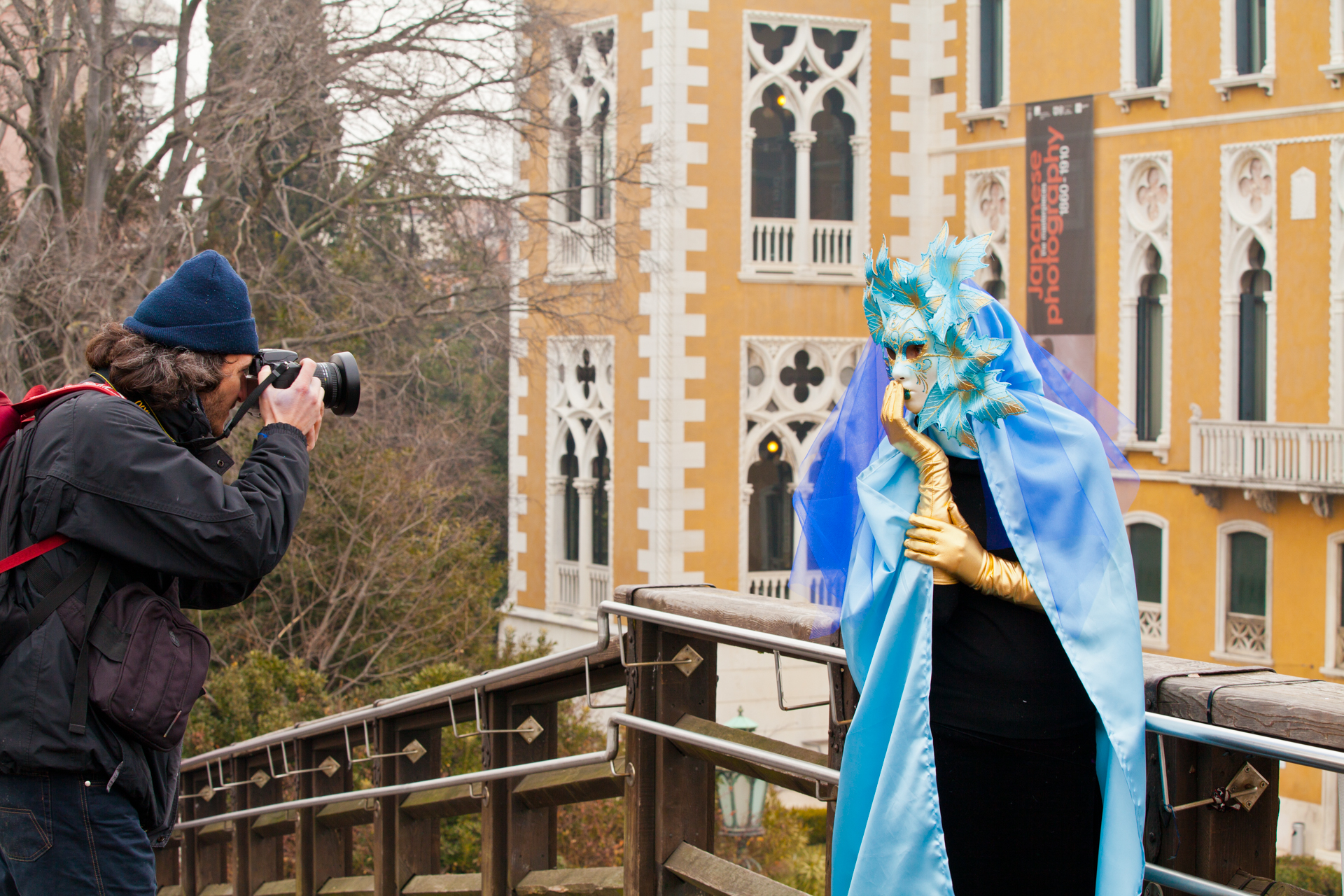 Photographer taking a picture of a reveler at Venice carnival