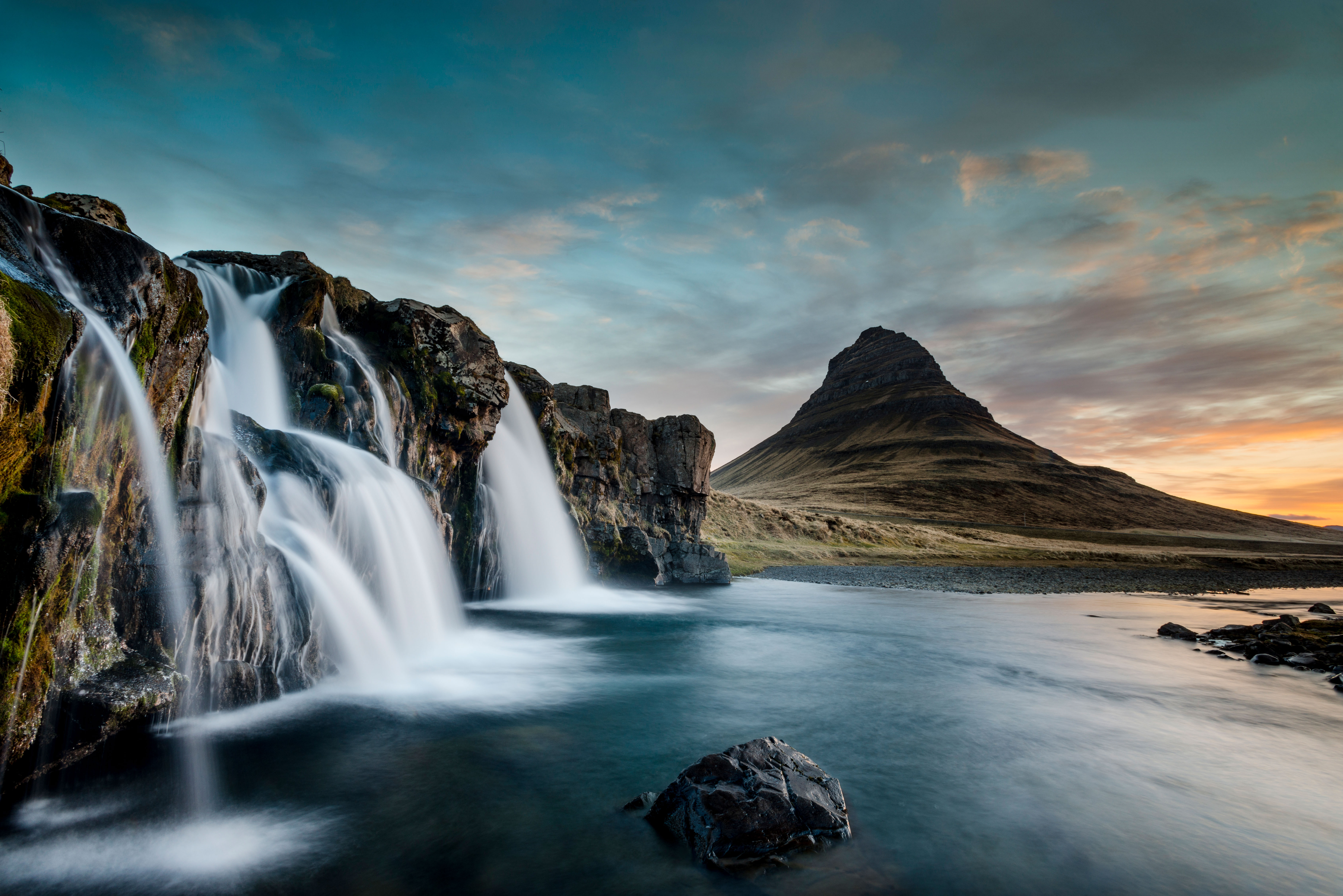 Kirkjufell mountain, Iceland, with a waterfall in the foreground at sunrise