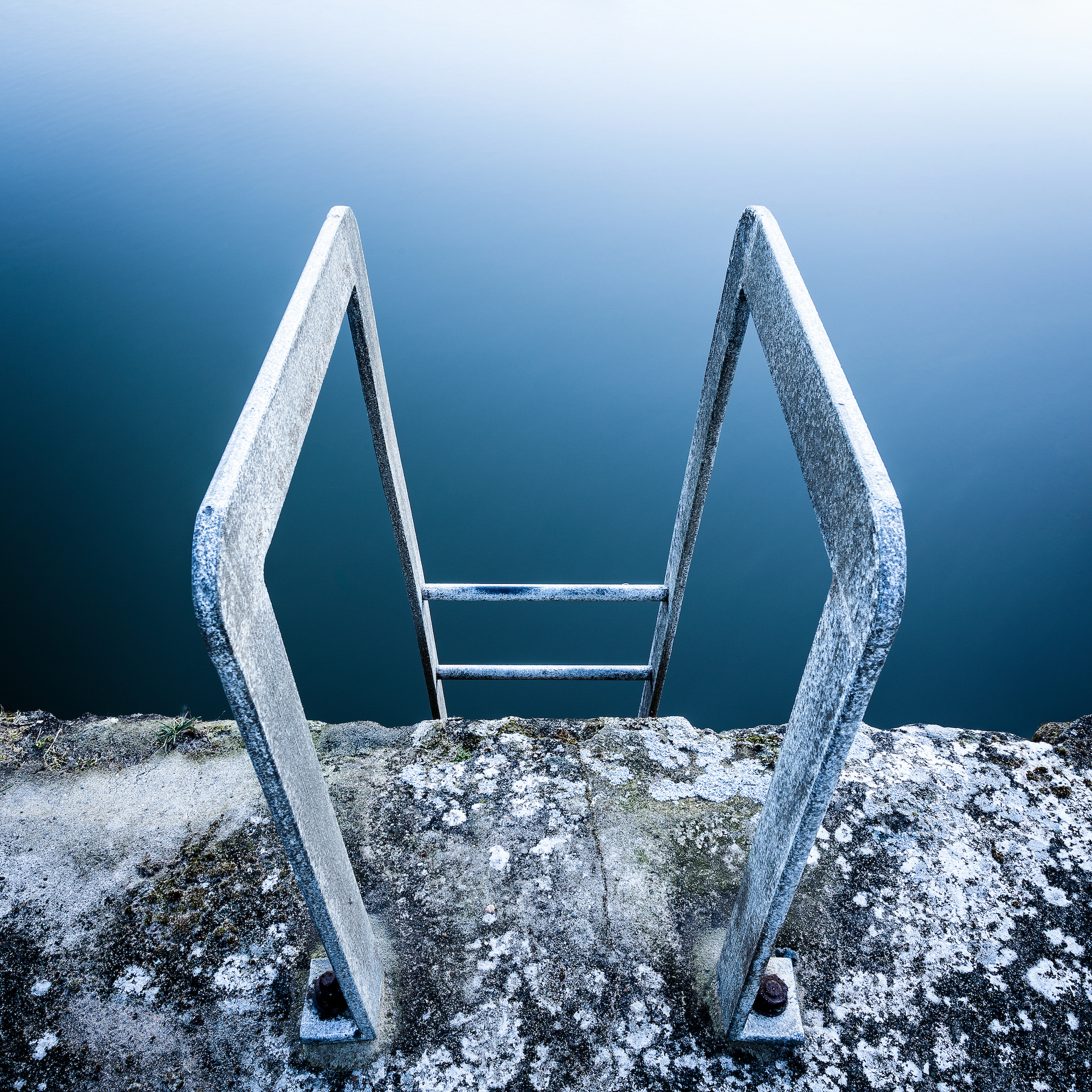 A fine art long exposure abstract of a metal ladder at Seaton Sluice harbour on the Northumberland coast.