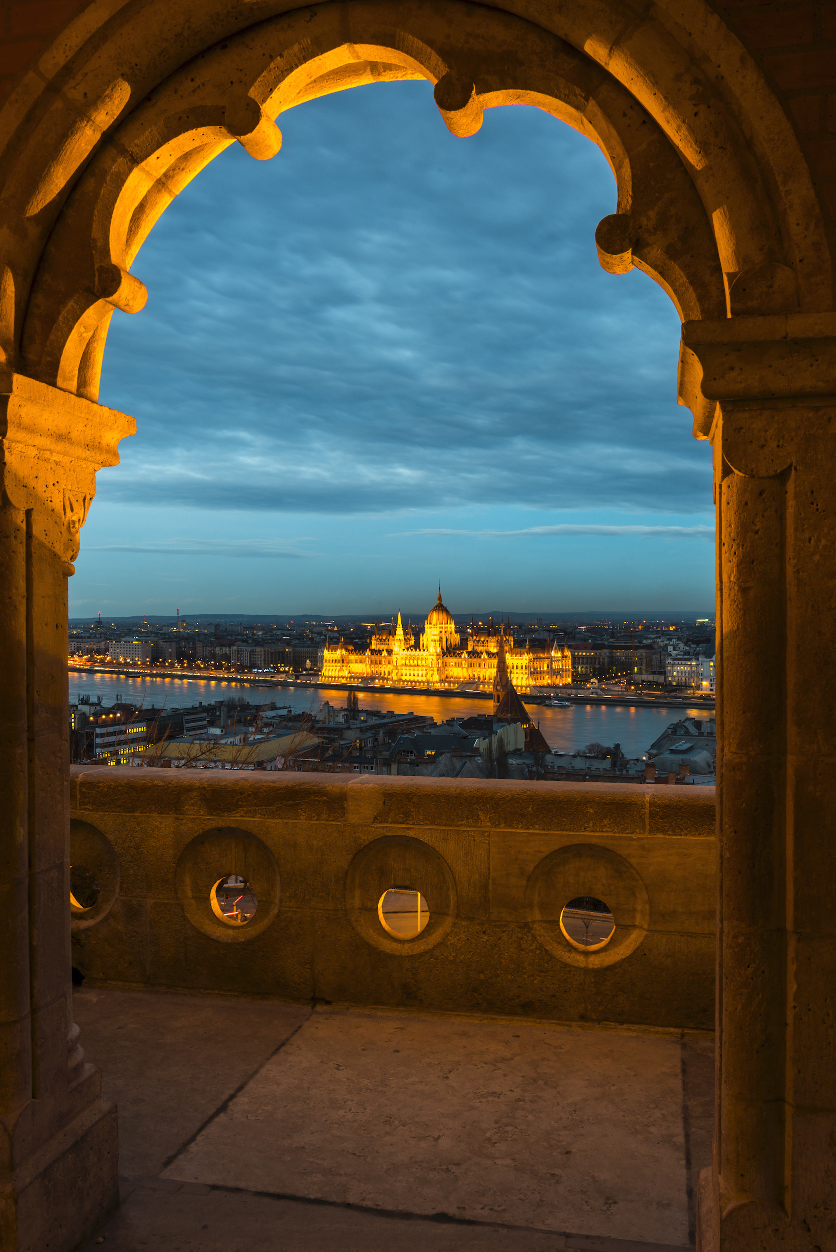 A view of the Hungarian Parliament from fishermens bastion in Budapest just after sunset and at the start of blue hour.